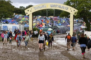 Wet festivals: Revellers walk through the muddy campsite at the Isle of Wight festival