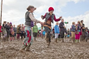 Wet festivals: Revellers dance in the mud at the Sunrise Celebration Festival in Somerset