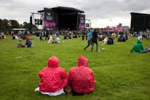 Wet festivals: Two people in matching raincoats at Hackney Weekend 2012