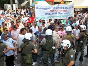 Shipyard workers demonstrate outside the Finance Ministry in Athens, Greece, protesting against changes in working conditions, on 10 July 2012.