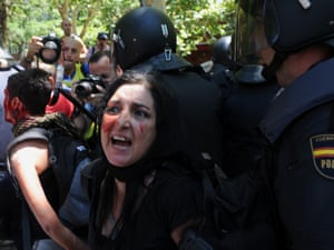 Riot policemen arrest demonstrators during clashes following a demonstration by Spanish coal miners in Madrid, on July 11, 2012 in protest at industry subsidy cuts that they say threaten their communities.