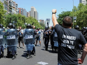 A demonstrator raises his fist in front of riot policemen during a demonstration by Spanish coal miners in Madrid, on July 11, 2012.