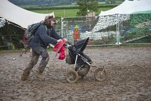 Wet festivals update: stroller through the mud at Sunrise Celebration Festival in Somerset