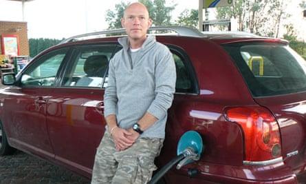 Miles Brignall filling his car at a petrol station Miles Brignall fills up his car with gas