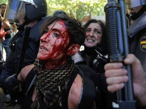 A woman is arrested by riot police during a demonstration by Spanish coal miners on July 11, 2012 in Madrid, Spain.
