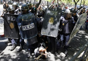 Miners reach Madrid: Riot policemen surround protesters during clashes following a miners' demo