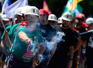 Miners reach Madrid: A Spanish coal miner holds a firecracker