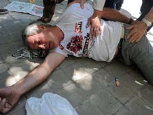 A man is tended to by police after collapsing during a demonstration by Spanish coal miners on July 11, 2012 in Madrid, Spain.