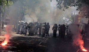 Miners reach Madrid: Riot policemen fire tear gas during a demonstration