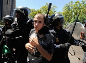 Miners reach Madrid: A protester is arrested by riot police
