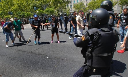 Riot police carrying rubber bullet launchers confront demonstrators during a coal miners march to the Minister of Industry building in Madrid, Wednesday, July 11, 2012.