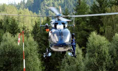 A helicopter rescue crew flies to Mont Maudit, Mont Blanc, where an avalanche killed at least six