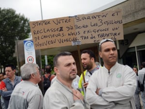 Workers of French carmaker PSA Peugeot Citroen demonstrate in front of the factory in Aulnay-sous-Bois, outside Paris, on July 12, 2012, after the group announced it would slash 8.000 jobs. AFP PHOTO MARTIN BUREAUMARTIN BUREAU/AFP/GettyImages