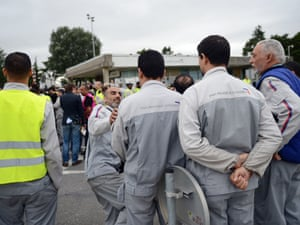 Workers of French carmaker PSA Peugeot Citroen demonstrate in front of the factory in Aulnay-sous-Bois, outside Paris, on July 12, 2012, after the group announced it would slash 8.000 jobs. PHOTO MARTIN BUREAUMARTIN BUREAU/AFP/GettyImages