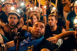 Spain miners: Miners rest after arriving at Puerta del Sol square