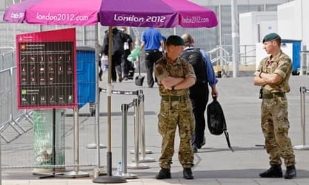 Soldiers guard a security checkpoint at an entrance to the London 2012 Olympic Park in London