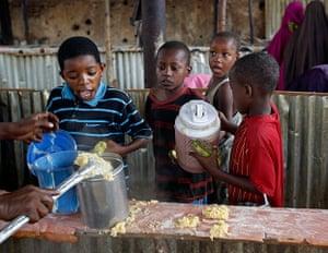 Mogadishu: A boy reacts during food distribution by an international NGO in Mogadishu