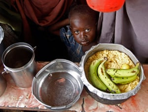 Mogadishu: A boy waits for food during a food distribution