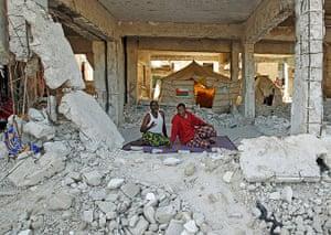 Mogadishu: Men sit in a building destroyed