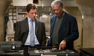 Freeman with Christian Slater in The Dark Knight Rises.