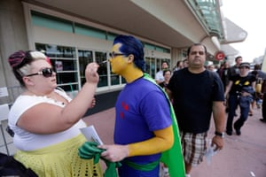 Comic con: Jenny Harlow applies makeup to Nick Bane as the wait to enter in Comic-Con