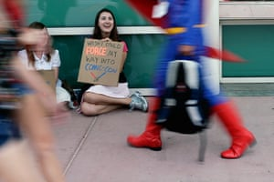 Comic con: Aaron Rickets holds a sign as she tries to gain entrance
