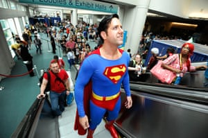 Comic con: Trey Moore, dressed as Superman, rides the escalator