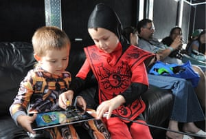Comic con: Comic Con attendees play Zombie Burbz in WowWee's AppGear truck