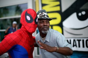 Comic con: Ray Senore poses with a man dressed as Spider-Man