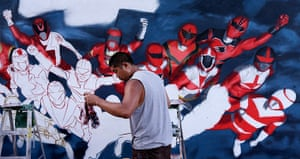 Comic con: Artist Swank One grabs a towel as he paints Power Rangers on a wall