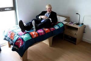 Olympic Village: Boris Johnson tests out a bed