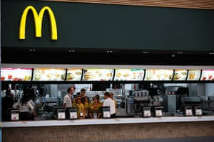 Olympic Village: Staff gather in a McDonald's serving area in the athlete's dining hall