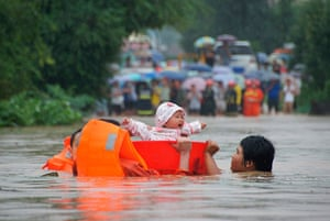 A Longer View - Flooding: Babies rescued from a standed bus during floods in China