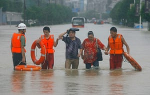 A Longer View - Flooding: Rescuers evacuate residents to a safer area