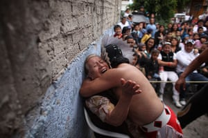 Lucha Libre, Mexico: Lucha Libre wrestler Mixteco Jr., hugs a woman