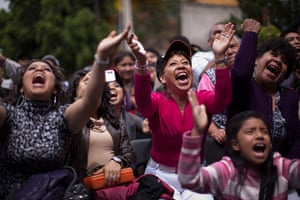 Lucha Libre, Mexico: Fans cheer as they watch wrestlers perform
