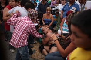 Lucha Libre, Mexico: Lucha Libre wrestler Johnny Villalobos lies among the audience