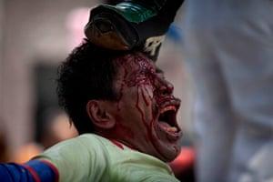 """Lucha Libre, Mexico: Lucha Libre wrestler """"Super Tarin"""" performs with artificial blood"""