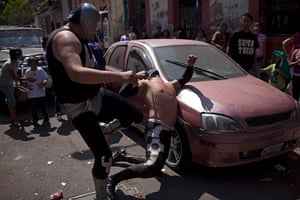 Lucha Libre, Mexico: Wrestlers Brazo de Plata Junior (L) and Shadow perform outside the ring