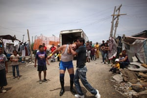 Lucha Libre, Mexico: Lucha Libre wrestler Super Tarin, right, bites the forehead of Leon Dorado