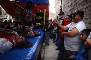 Lucha Libre, Mexico: Fans watch as watch Mexican Lucha Libre wrestlers are beaten