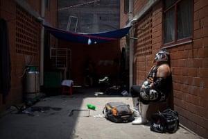 Lucha Libre, Mexico: Lucha Libre wrestler Lunathor rests in an alleyway