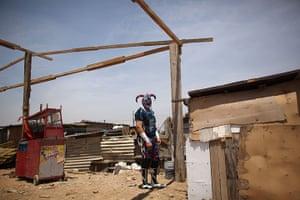 Lucha Libre, Mexico: Lucha Libre wrestler Crazy Clown waits to use a restroom