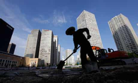 A labourer works at a construction site in Beijing's central business district