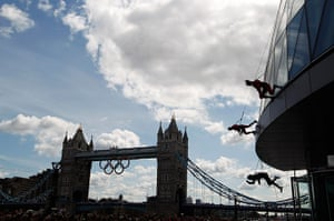 Streb Dance London: Members of Streb abseil down the face of City Hall, Tower Bridge behind