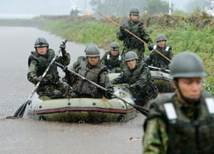 Floods in Japan: Self-Defence Force soldiers search for missing people in Aso