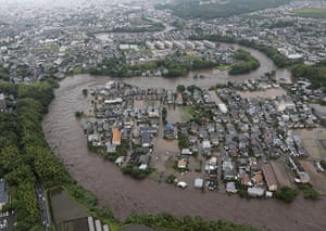 Floods in Japan: Residential streets are submerged after a river overflowed in Kumamoto