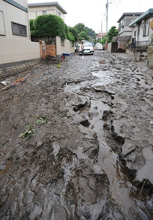 Floods in Japan: A road is covered in mud in Kumamoto city