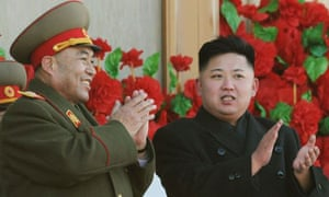 Ri Yong-ho, shown with the country's young leader, Kim Jong-un