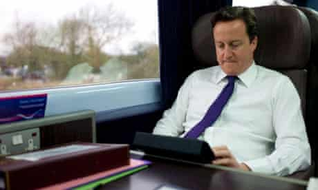 David Cameron on a train last year to Swansea, where the railway line is to be electrified